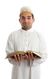 Smiling man holding a book Royalty Free Stock Image