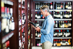 Smiling man holding bottle of wine Royalty Free Stock Photography