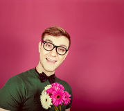 Smiling man holding a bouquet of flowers Stock Images