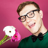 smiling man holding a bouquet of flowers Stock Photo
