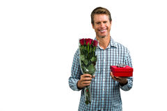 Smiling man holding bouquet of roses Royalty Free Stock Photo