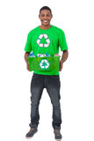 Smiling man holding box of recyclables Royalty Free Stock Images