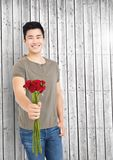 Smiling man holding bunch of flowers Stock Image