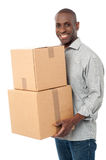 Smiling man holding cardboard boxes Stock Image