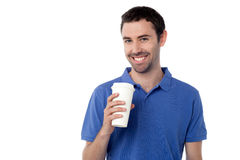 Smiling man holding cold beverage Royalty Free Stock Image