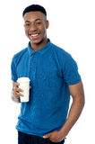 Smiling man holding cold beverage Stock Images