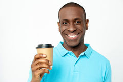 Smiling man holding cold beverage Royalty Free Stock Images