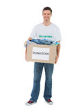 Smiling man holding donation box Stock Photo