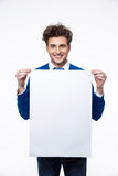Smiling man holding empty paper Royalty Free Stock Image