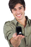 Smiling man holding engagement ring Royalty Free Stock Image