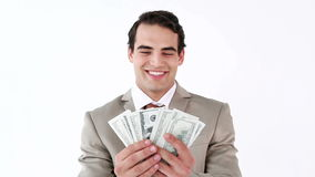 Smiling man holding a fan of dollar notes Royalty Free Stock Image