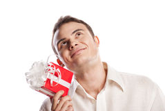 Smiling man holding gift isolated on white Royalty Free Stock Photography
