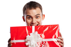 Smiling man holding gift isolated on white Stock Photography
