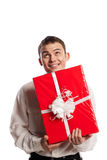 Smiling man holding gift isolated on white Stock Image