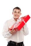 Smiling man holding gift isolated on white Royalty Free Stock Photo
