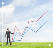 Smiling man holding graph line. Business, development and people concept - smiling man holding graph line over chart background Stock Photography
