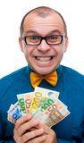 Smiling man holding handful of money. Isolated on white Stock Photography