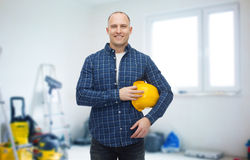 Smiling man holding helmet over room background Royalty Free Stock Photos