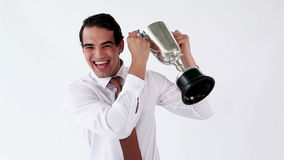 Smiling man holding his cup. Against a white background stock video