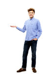 Smiling man holding invisible product Royalty Free Stock Photo
