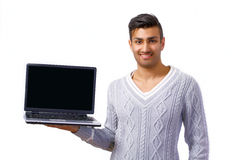 Smiling man holding laptop Royalty Free Stock Image