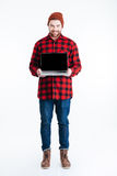 Smiling man holding laptop and looking at camera Stock Photos