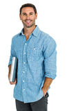 Smiling man holding laptop looking at the camera Royalty Free Stock Photos