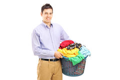 A smiling man holding a laundry basket Stock Image