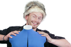 Smiling man holding mannequin Royalty Free Stock Photography