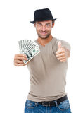 Smiling man holding money Stock Photos