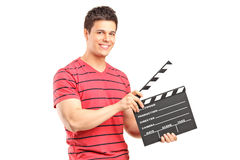 A smiling man holding a movie clap Royalty Free Stock Images