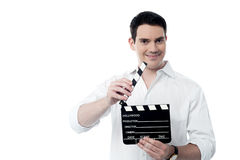 Smiling man holding a movie clap isolated on white Stock Photography