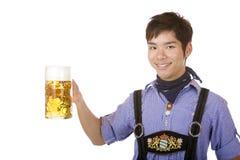 Smiling man holding Oktoberfest beer stein (Mass) Stock Images