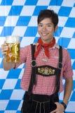 Smiling man holding Oktoberfest beer stein (Mass) Stock Photography