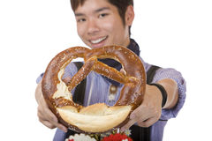 Smiling man holding Oktoberfest pretzel Royalty Free Stock Photo
