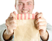 Man holding paper bag Royalty Free Stock Photo