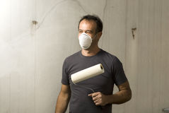 Smiling Man Holding Paint Roller - Horizontal Royalty Free Stock Photography