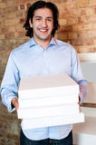 Smiling man holding pizza boxes Stock Photography