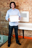 Smiling man holding pizza boxes Royalty Free Stock Image