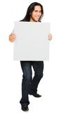 Smiling man holding placard Royalty Free Stock Photos