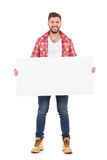 Smiling man holding placard Royalty Free Stock Photography