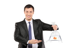 Smiling man holding a plastic bag with fish Stock Image