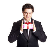 Smiling man holding present box Stock Photo