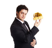 Smiling man holding present box Stock Images