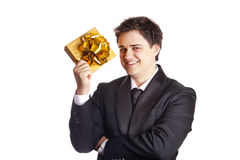 Smiling man holding present box Royalty Free Stock Photography