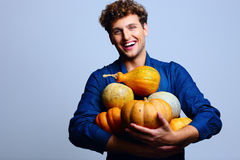 Smiling man holding pumpkins Stock Photography