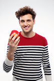 Smiling man holding red apple Stock Photos