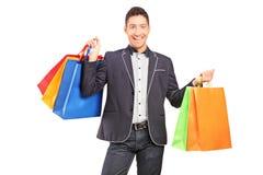 A smiling man holding shopping bags Stock Photos