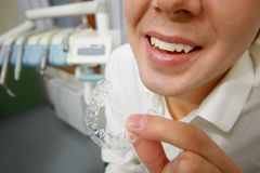 Smiling man holding silicone mouth guard Royalty Free Stock Image
