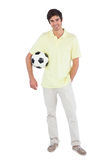 Smiling man holding soccer ball Royalty Free Stock Images